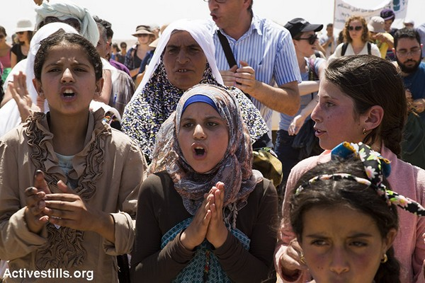 Palestinian girls chant slogans at the protest against the demolition of their village, Susya, July 24, 2015. (Keren Manor/Activestills.org)