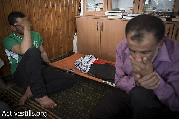 Palestinian relatives mourn the death of 18-month-old Ali Dawabshe, after he was killed in an arson attack by Jewish settlers, Duma, West Bank, July 31, 2015. (photo: Oren Ziv/Activestills.org)