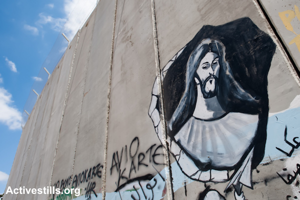 A mural portraying Jesus is painted on the Israeli separation wall dividing the West Bank town of Bethlehem, July 28, 2010. (photo: Ryan Rodrick Beiler/Activestills.org)