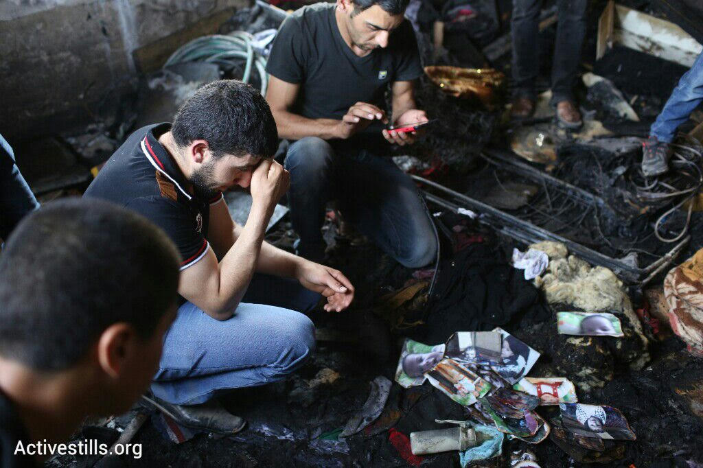 Palestinians mourn the death of Palestinian baby Ali Saad Dawabshe who was killed by Israeli settlers in an overnight arson attack, Douma, West Bank, July 31, 2015. (Oren Ziv/Activestills.org)