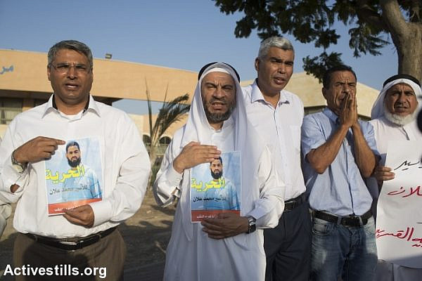 Palestinians shout slogans during a protest for the release of Palestinian Mohammed Allan, who is held by Israel without trial and who has slipped into a coma after a nearly two-month hunger strike, in the city of Bedouin city of Rahat, August 18, 2015. (photo: Oren Ziv/Activestills.org)