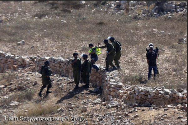 Soldiers arrest Palestinian photographer Bilal Tamimi and Israeli artist David Reeb during a weekly protest against the occupation, Nabi Saleh, West Bank, August 21, 2015. (photo: Haim Schwarczenberg)