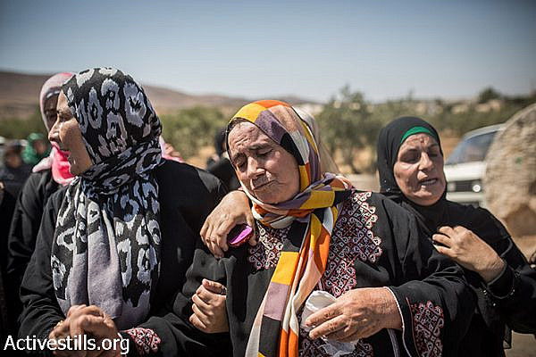 Mother of Saad Dawabsheh (center) reacts during her son's funeral procession, in the West Bank village of Duma, August 8, 2015. Saad Dawabsha and his toddler son Ali, 18-months-old, were burned to death in an arson attack by Jewish extremists on their house last week. Saad died of his injuries after a week in the hospital, while his wife still fights for her life. (Yotam Ronen / Activestills.org)