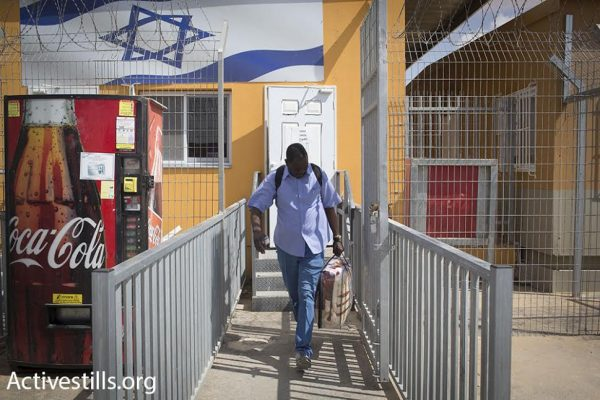 An asylum seeker leaves Holot detention center, Negev Desert, southern Israel, August 25, 2015. (photo: Oren Ziv/Activestills.org)