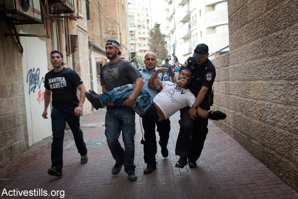 Illustrative photo of Israeli police arresting a right-wing activist wearing a T-shirt that reads 'Death to the terrorists' in West Jerusalem. (Activestills.org)