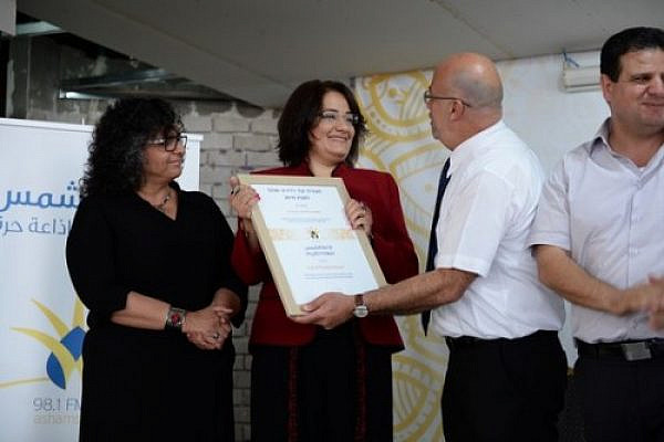Samah Salaime honored with award from a-Shams Radio, Photo: Nabil Hakim, 2015.