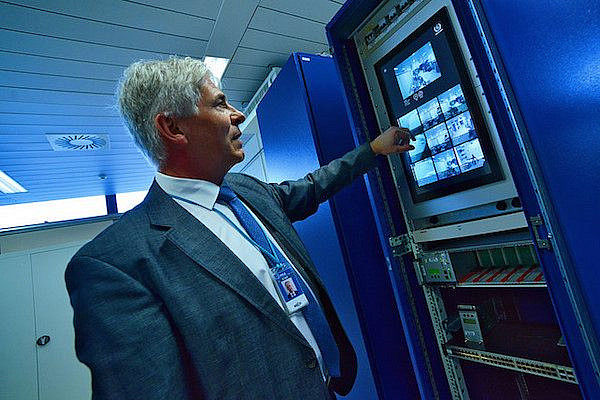 An IAEA expert demonstrating how the safeguards Next Generation Surveillance System (NGSS) works, March 20, 2015. (Photo: Dean Calma / IAEA)