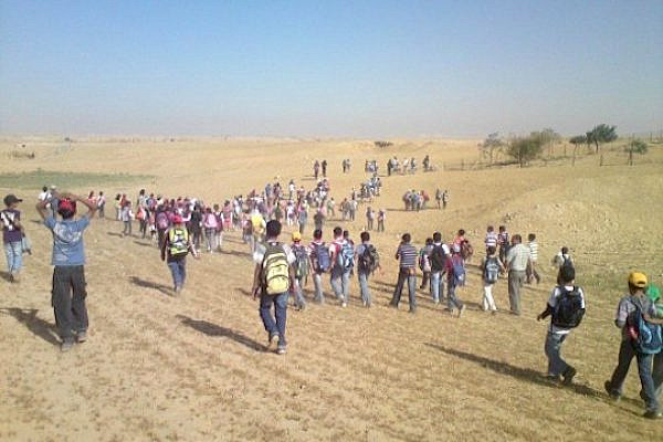 Bedouin children walking to school in the Naqab/Negev. (Photo from Adalah)