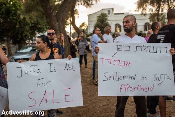 Local residents protest against the plan to build a new housing project for Jews only in the middle of the Palestinian neighborhood of Ajami, Jaffa, August 22, 2015. (Yotam Ronen/Activestills.org)