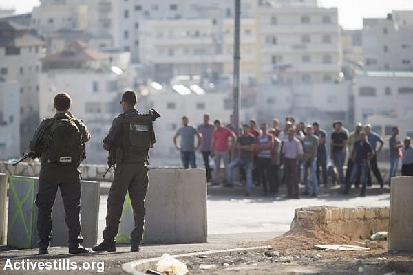 Israeli Border Police officers man a checkpoint for Palestinians leaving the East Jerusalem neighborhood of Issawiya, October 15, 2015. (Oren Ziv/Activestills.org)