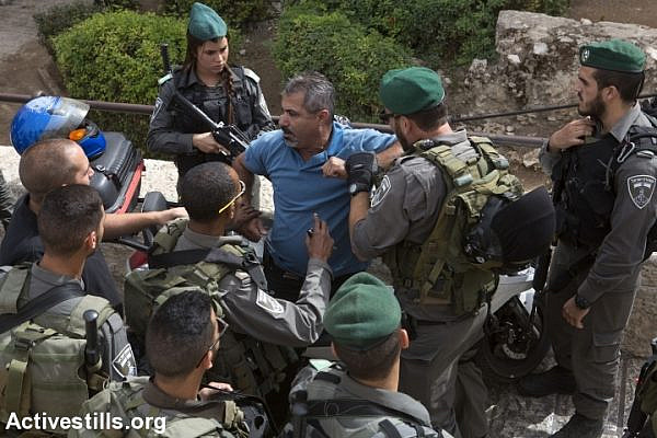 Israeli forces assault a Palestinian man near Damascus Gate, in the Old city of Jerusalem, October 23, 2015. Many new checkpoints have been set up in the Palestinian quarters of Jerusalem. Tensions rise in recent weeks with violent attacks by both Israelis and Palestinians and clashes around the West Bank, the Gaza Strip, Jerusalem and Palestinian towns inside Israel. (photo: Anne Paq/Activestills.org)