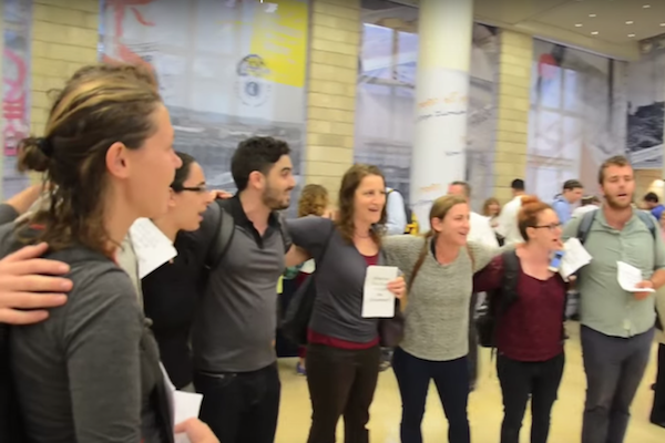 Members of the Center for Jewish Nonviolence and All That's Left sing a Jewish hymn during a direct action at the World Zionist Congress in Jerusalem, October 20, 2015. (photo: Laura Gottesdiener)