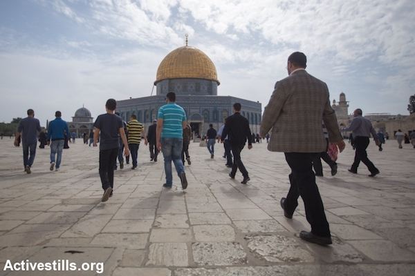 Palestinian worshippers walk toward the Dome of the Rock at Al-Aqsa Mosque compound before Friday prayers, the Old City of Jerusalem, November 14, 2014. (Faiz Abu Rmeleh/Activestills.org)