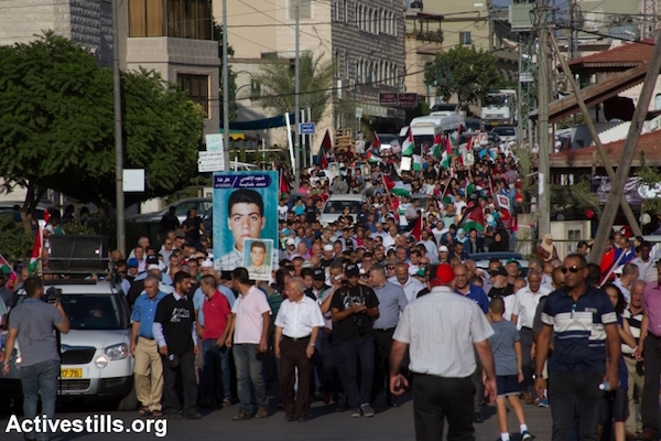 Palestinian citizens of Israel march to commemorate the killing of 13 protesters by Israeli police in October 2000, Sakhnin, October 1, 2015. (Omar Sameer/Activestills.org)