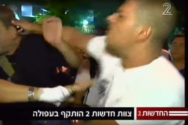 Screenshot of Israelis attacking Channel 2 crew in northern Israeli city of Afula.
