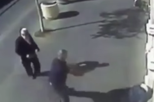An armed security guard shoots a Palestinian teenager after she attempted to stab passersby, Jerusalem, November 24, 2015. (screenshot: CCTV)