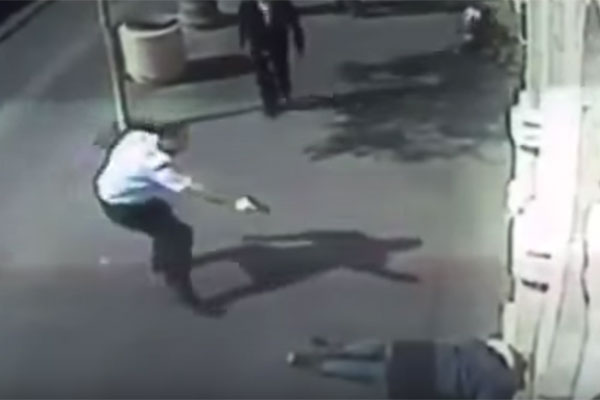 Screenshot of CCTV footage showing a man shooting a Palestinian teenage girl who stabbed an elderly Palestinian man in Jerusalem, November 23, 2015.