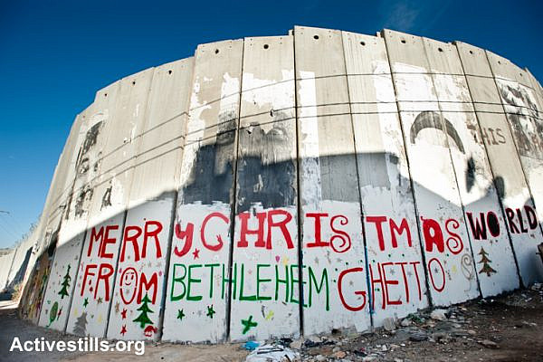 "Graffiti on the Israeli separation wall in the West Bank town of Bethlehem reads, ""Merry Christmas from Bethlehem Ghetto,"" December 16, 2010."