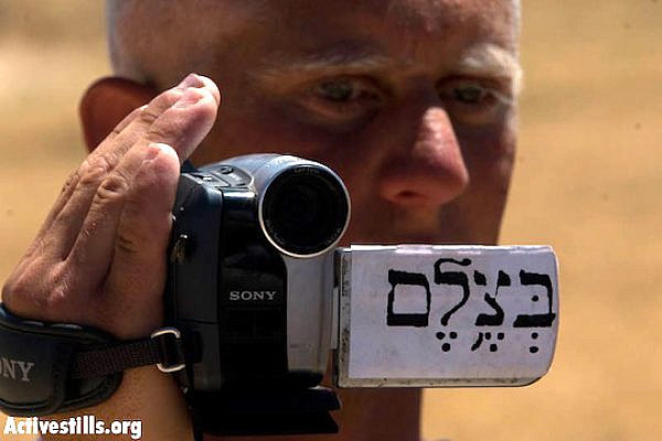 A Palestinian B'Tselem volunteer documenting a protest in the south Hebron Hills, June 14, 2008. (Oren Ziv/Activestills)