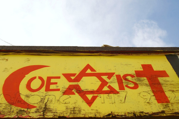 Coexist (Photo by 1000 Words / Shutterstock.com)