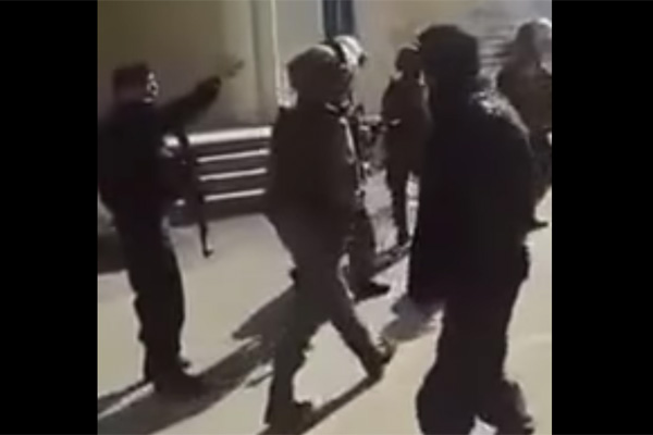 Screenshot of Palestinian police arguing with Israeli Border Police troops.