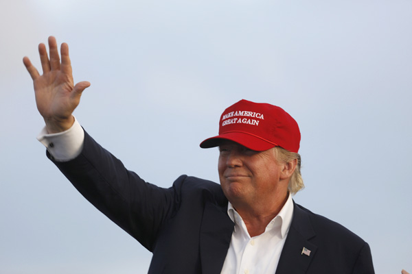 Donald Trump waves during a campaign rally in Los Angeles, September 15, 2015. (Joseph Sohm / Shutterstock.com)