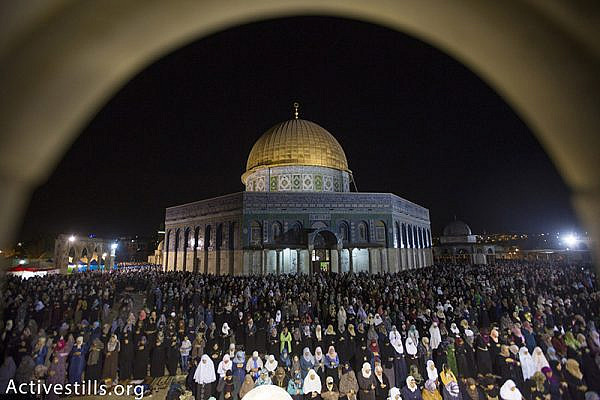 Palestinian Muslim worshippers pray overnight during Laylat al-Qadr, outside the Dome of the Rock in the Al-Aqsa mosque compound in Jerusalem's Old City, July 13, 2015. Layal al-Qadr, falls on the 27th day of the fasting month of Ramadan, marking the night Muslims believe the first verses of the Koran were revealed to the Prophet Mohammed through the archangel Gabriel. Activestills.org