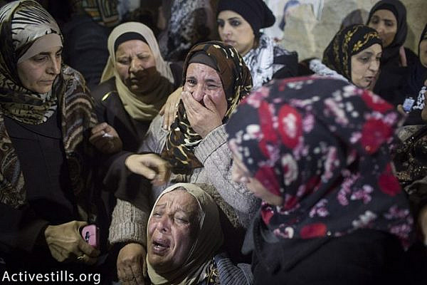 Palestinian women mourn during the funeral of Hadeel Awwad in Qalandiya refugee camp, December 18, 2015 (Activestills.org). Israel had held onto Hadeel's body for almost a month.
