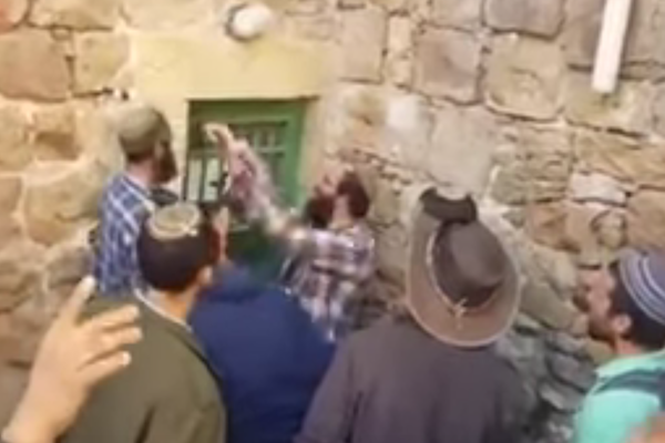 Screenshot of Israelis taking over an empty home in Hebron.