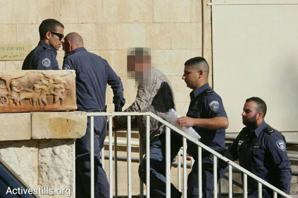 Israeli left-wing activist is led into the Jerusalem Magistrate's Court, January 12, 2015. (Oren Ziv/Activestills.org)