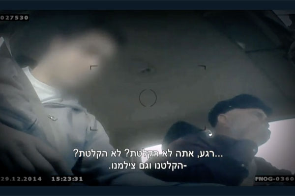 The right-wing organization, 'Ad Kan,' sent its employees to infiltrate human rights organizations and record their every move with hidden cameras. The man on the left is the 'infiltrator,' Ezra Nawi is on the right. (Screenshot)