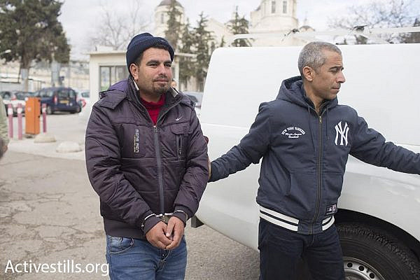 Palestinian anti-occupation activist Nasser Nawajah is accompanied by Israeli attorney Gabi Lasky (right) as he enters the Jerusalem Magistrate's Court, January 20, 2016. (photo: Oren Ziv/Activestills.org)