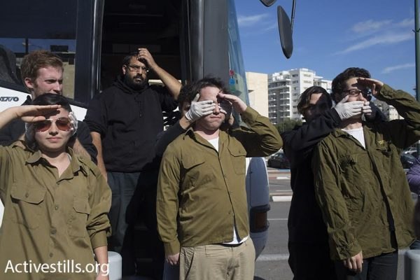 Demonstrators organize a performance in support of Tair Kaminer, a 19-year-old Israeli conscientious objector, at the Tel Hashomer induction base, Ramat Gan, Israel, January 10, 2016. (photo: Oren Ziv/Activestills.org)