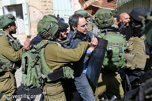 Israeli soldiers arrest Professor Gadi Algazi at a demonstration in Hebron calling on the army to ''open the Hebron Ghetto,' Hebron, West Bank, February 20, 2016. (photo: Oren Ziv/Activestills.org)