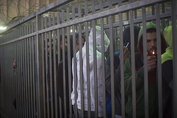 Much of the time spent waiting in Qalandiya checkpoint is spent in narrow, fenced lanes that resemble cattle holds. (Activestills.org)