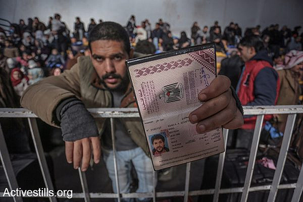 A Palestinian man holds his identification card as he waits at the Rafah crossing, hoping to leave the Gaza Strip into Egypt, February 13, 2016. (Ezz Al Zanoon/Activestills.org)