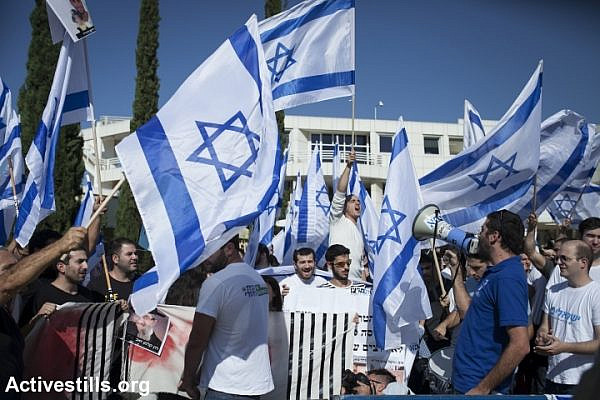 Right-wing activists from 'Im Tirzu' protest at the entrance to the Tel Aviv University, November 20, 2014. (photo: Shiraz Grinbaum/Activestills.org)