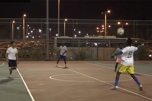 Asylum seekers from Holot play soccer with Israeli students in Be'er Sheva. (Social TV)