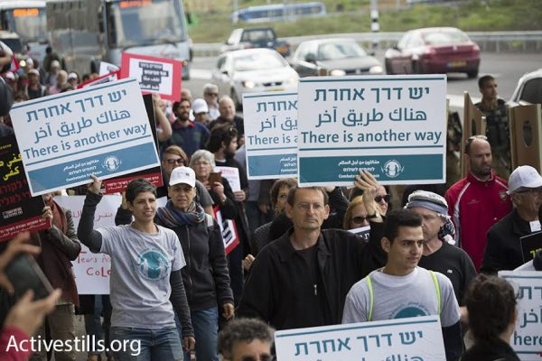 Israeli and Palestinian demonstrators, including Joint List MK Dov Khenin, take part in a march against the occupation, Beit Jala, West Bank, March 4, 2016. (photo: Oren Ziv/Activestills.org)