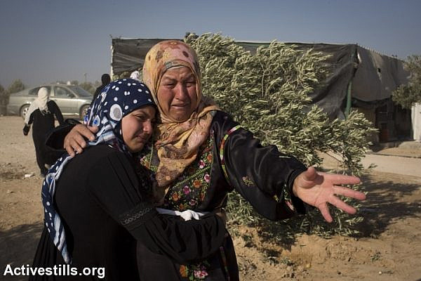 Bedouin women react after Israeli police arrested two boys who were building a shack in the unrecognized Bedouin of Al-Araqib in the Negev desert, one day after the entire village was demolished by the Israeli authorities, June 13, 2014. (photo: Oren Ziv/Activestills.org)