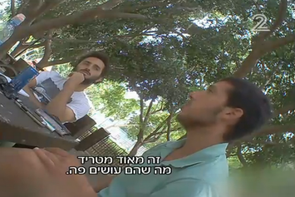Screenshot from Ad Kan's hidden camera, capturing Breaking the Silence interviewing a right-wing mole.