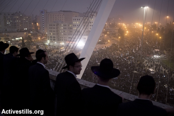 Ultra-Orthodox Jewish men take part in a mass prayer protest against drafting religious Jews into the Israeli army, Jerusalem, March 2, 2014. (Oren Ziv/Activestills.org)