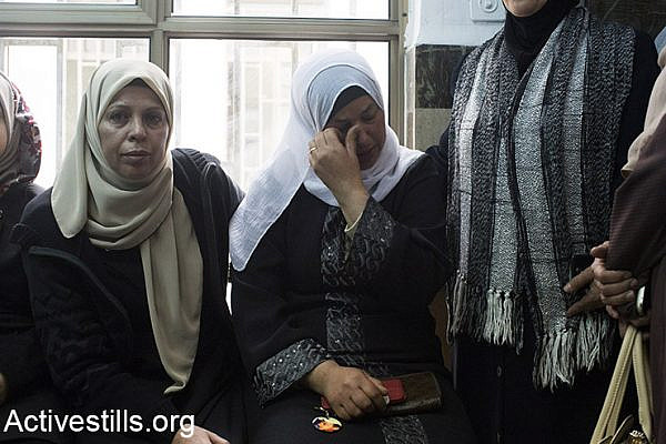 (Suha (C), the mother of Palestinian teenager Mohammed Abu Khdeir, who was murdered last year, sits in the district court in Jerusalem on November 30, 2015. The Jerusalem court convicted two Israeli minors of the kidnapping and burning alive of a Palestinian teenager in the run-up to the 2014 Gaza war, while the third defendant Yosef Haim Ben-David's mental state will be evaluated. Mohammed Abu Khdeir, 16, was abducted and killed on July 2, 2014, weeks after the kidnapping and murder of three Israeli teenagers in the West Bank. Activestills.org)