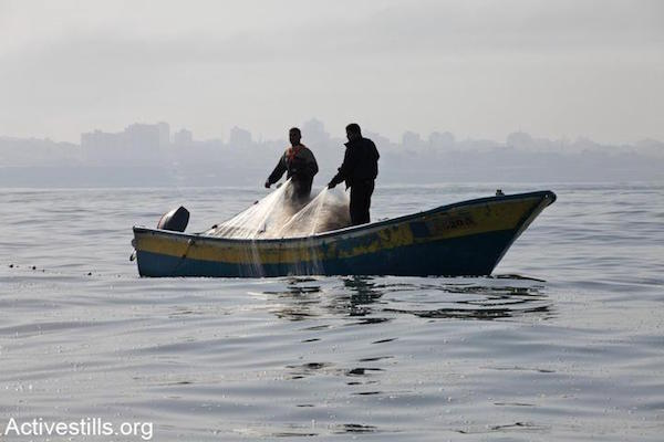 Fisherman reel in their nets off the shore of the Gaza Strip. File photo. (Anne Paq/Activestills.org)