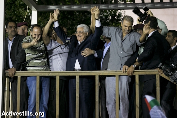 Palestinian President Mahmoud Abbas embraces Palestinians recently released from Israeli prisons at a ceremony in the West Bank city of Ramallah, August 14, 2013. (Yotam Ronen/Activestills.org)