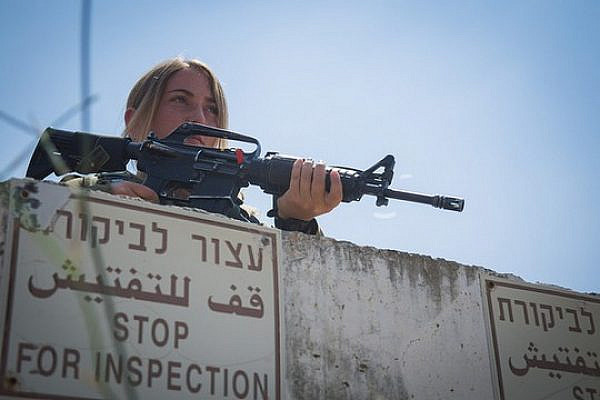 An Israeli soldier stands watch at a checkpoint near the West Bank city of Nablus. (IDF Spokesperson)