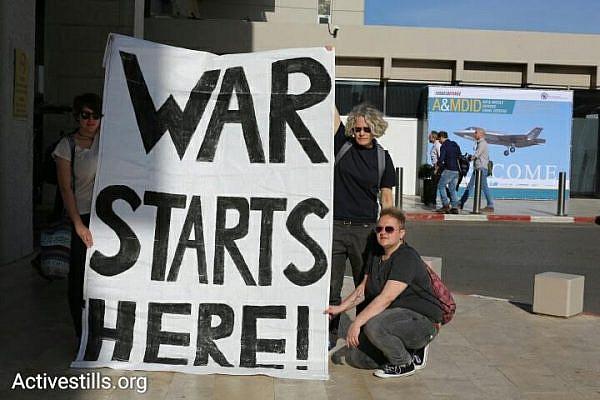 Anti-war activists protest against the The International Air Conference, outside the Tel Aviv Hilton, April 3, 2016. (photo: Oren Ziv/Activestills.org)