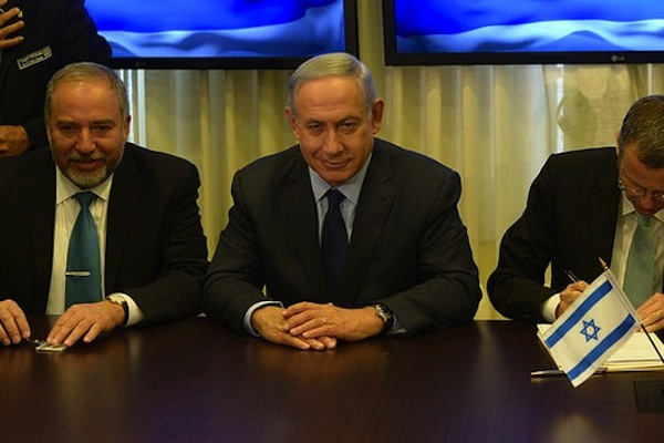 Prime Minister Benjamin Netanyahu (center) and Defense Minister Avigdor Liberman (left) at a ceremony to mark Yisrael Beitenu joining the coalition. (photo: Amos Ben Gershom/GPO)
