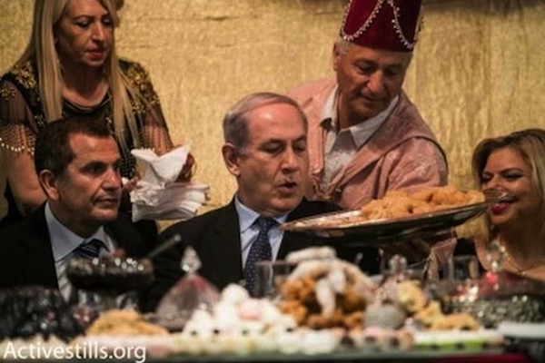Prime Minister Netanyahu and Sara Netanyahu (right) during a Mimouna celebration. (photo: Activestills.org)