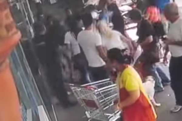 Screen shot of Border Police allegedly beating Arab worker outside central Tel Aviv supermarket.